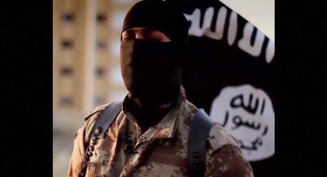 A masked man speaking in what is believed to be a North American accent in a video that Islamic State militants released in September 2014 is pictured in this still frame from video