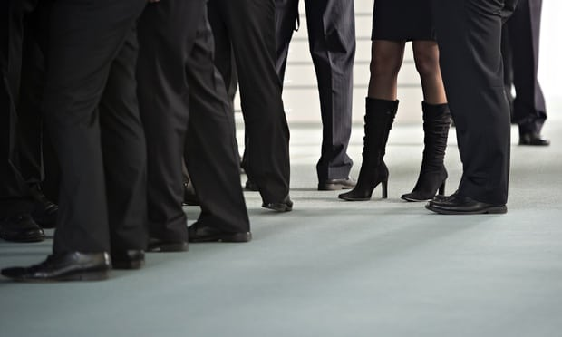 Business women's legs among men in suits
