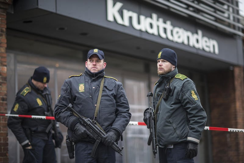 Police guard the scene of a shooting at cafe 'Krudttonden,' which was hosting a free speech event, in Oesterbro, Copenhagen