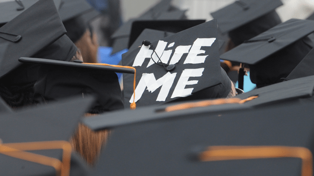 Hire-Me-sign-in-a-graduation-hat